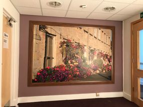Large wall murals - installation of framed art for corporate, healthca